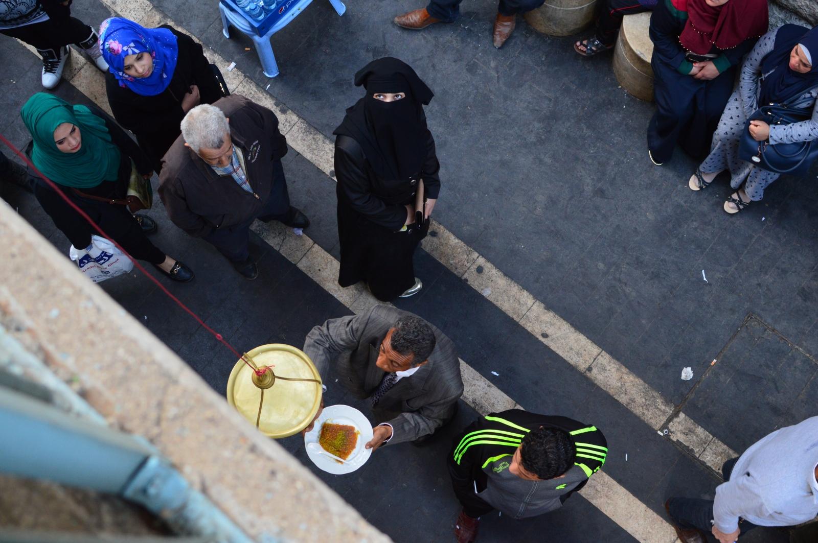 An impatient crowd waits impatiently for the best knakeh in town. Amman, Jordan