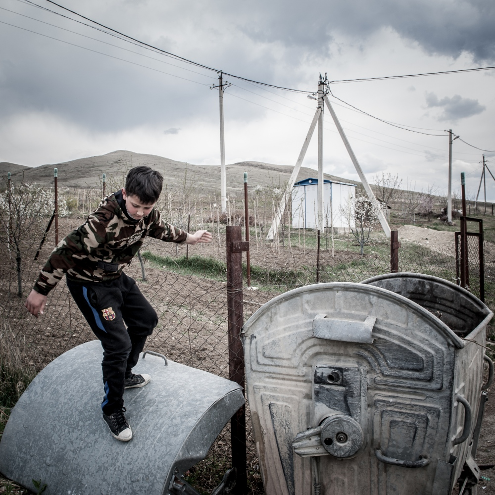 A young boy playing in the streets of the village of Gori, one of the refugee container camps built by Georgian government. Unemployed is high and the situation for refugees still extremely difficult.