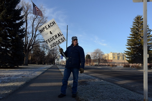 Ronald Posey protests across the street from the county courthouse.