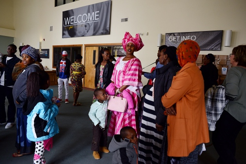 Families wait in the lobby after Congolese prayer service at the First Church of the Nazarene. Twin Falls, Idaho