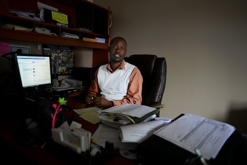 Zeze Rwasama in his office at the Refugee Center.