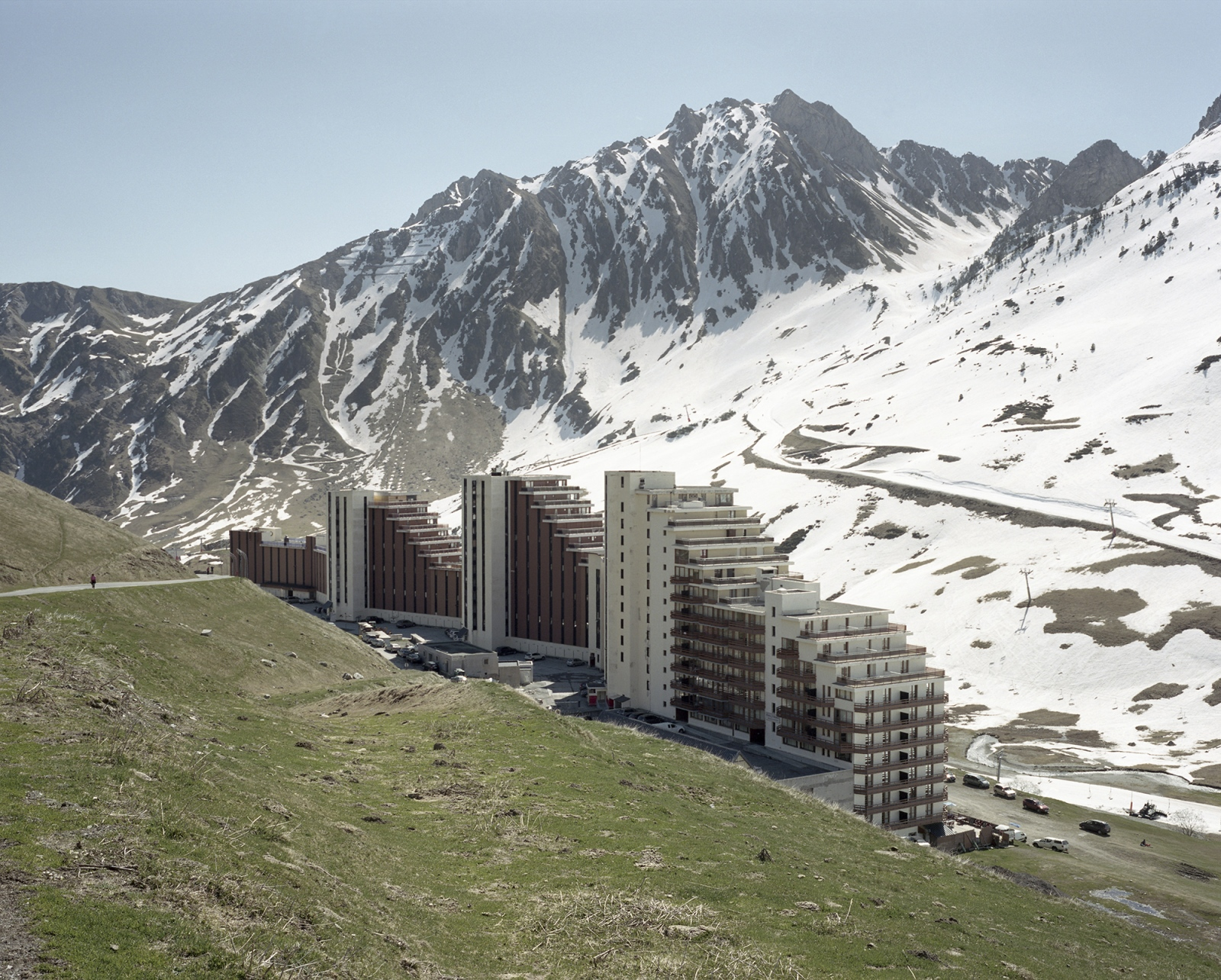 France, La Mongie. A view of a building belonging to a ski resort. According to the European Environment Agency, Europe's mountain regions may suffer some of the most severe impacts of climate change. Increasing temperatures can change snow-cover patterns and lead to water shortages and other problems such as reduced ski tourism.