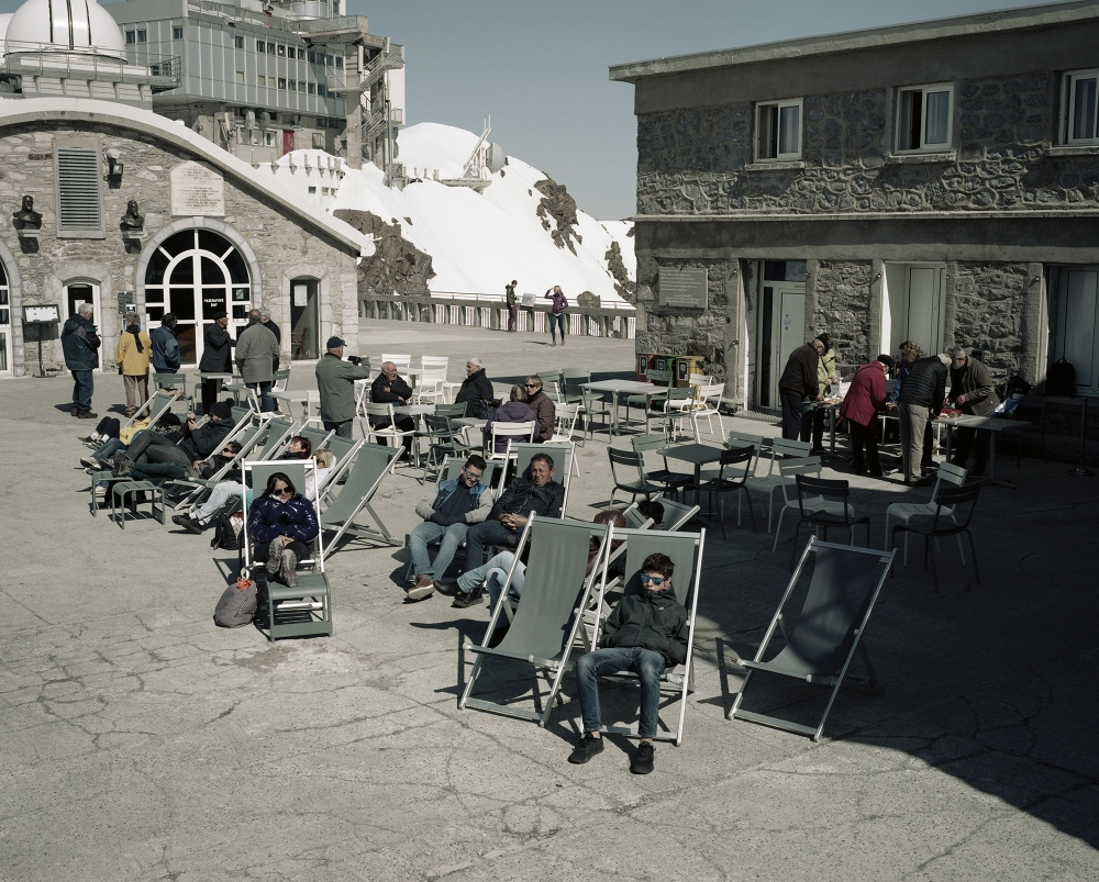 France,Pic du Midi. Tourists relax at the top of the Pic du Midi where is located the higher Astronomy Observatory of Europe.