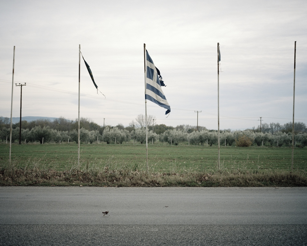 Greece, Promqchonas. Greek flags on the border of the road. The Greek Macedonia is one of the poorest region of the country.