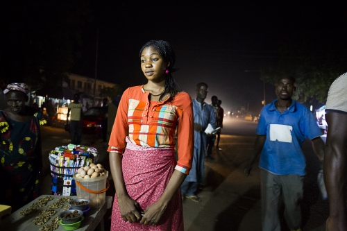 Linda Daniel, 19, a cook at the night market in Yola, Nigeria. 2015