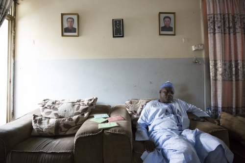 Portraits of Kim Il Sung and Kim Jong Il of North Korea hang on Professor Alhassan Muhammad's sitting room wall. Alhassan, 54, is the chairman of the Nigerian-DPRK Friendship Association Abuja, Nigeria, 2017. ( Buzzfeed article )