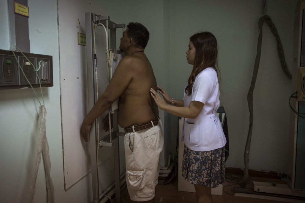 Bunsri Mamak, 50, takes an X-ray to see the effect of the disease on his lungs at the weekly Melioidosis clinic at Sapphasit Prasong Provincial Hospital. Because of the slow diagnosis of the disease he almost died and had to spend 13 days in ICU at this hospital.  Ubon Ratchathani - Thailand