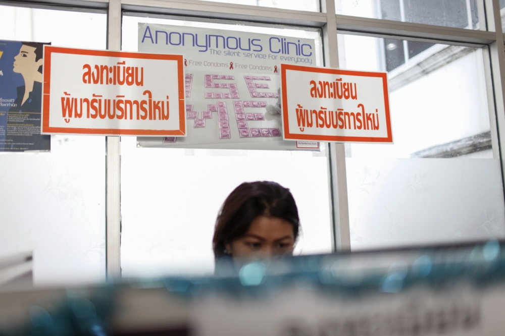 A member of staff at the clinic sits at a computer that new visitors to the clinic first register on in booths before seeing a doctor at the Anonymous Clinic at the Thai Red Cross AIDS Research Centre in Bangkok.  Bangkok - Thailand