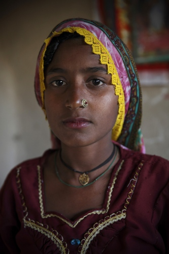 A portrait of Khaton Bheel, age 15, whose family were en-slaved on a remote farm in eastern Pakistan. After being rescued she has now lived in the 'freed-slave' village since 2005. Pakistan has one of the largest bonded labour rates in the world.  Sindh Province - Pakistan