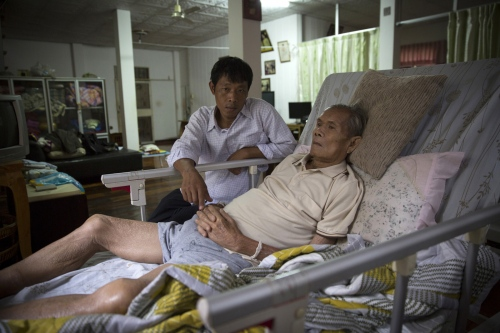 Melioidosis victim Garn Wongsuvan, 82, rests in his home after being diagnosed several months ago. Mr Garn has Leukaemia and usually doesn't go anywhere. But one day when feeling better he went to walk in his rice fields to get some exercise. That is where it is believed he caught the disease from.  Ubon Ratchathani - Thailand