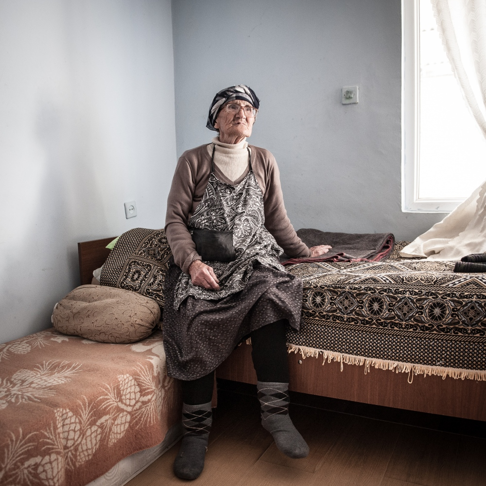 "Jujuna Beruashvili, 76, who lives in the village of Sveneti, one of the refugee container camp built up by the Georgian government. ""We are from Tskhinvali, Eredvi. We live alone here. My pension is not enough for buying the medicines. We have no money for food."""