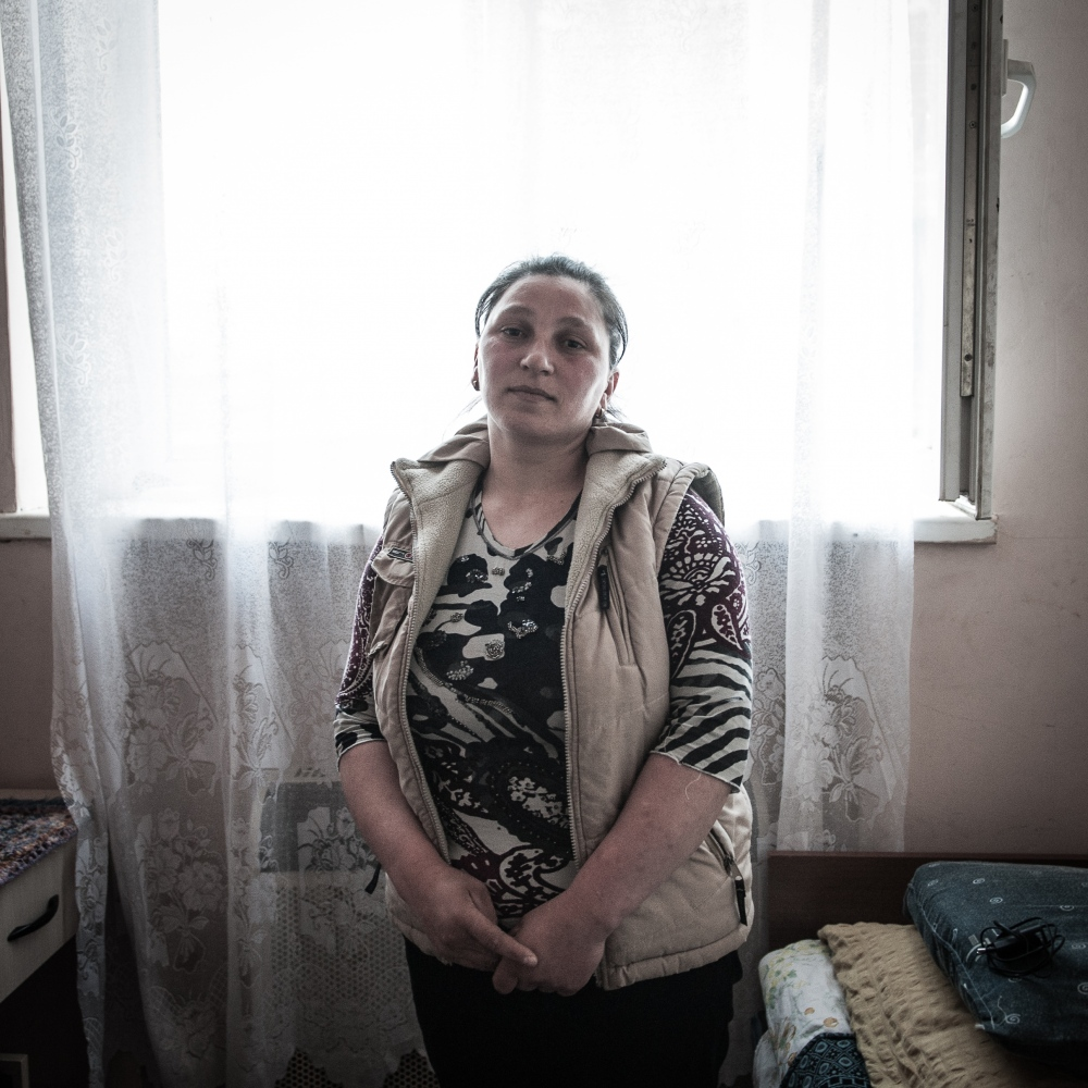 "Asmat Kharauli, 33, lives in a building for refugees in the village of Khasuri, next to the border with South Ossetia. ""I moved here from the village of Znauri. Most of our problems are economical. We receive only refugee pensions and we can't find a job at all."""