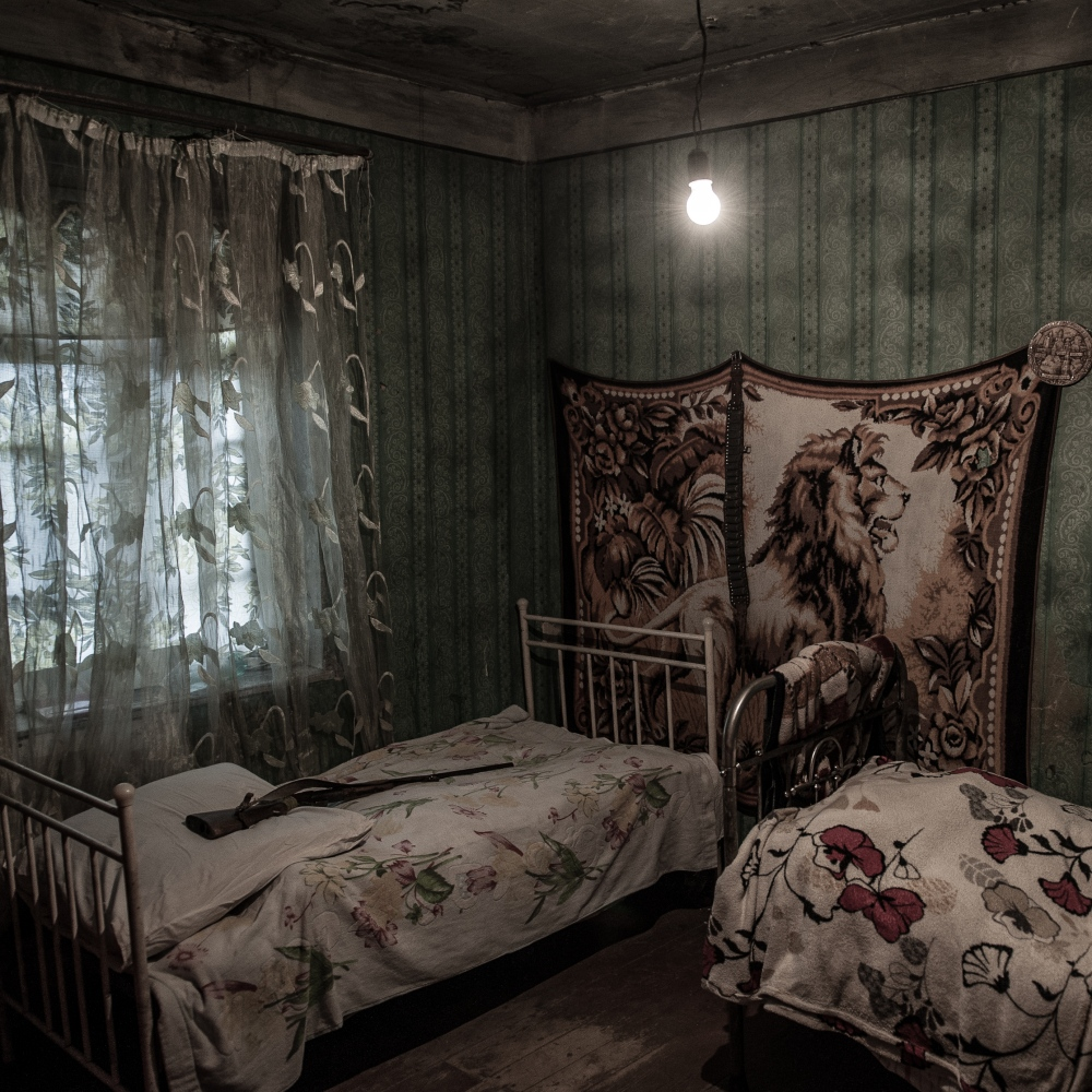 A bedroom in one of the houses of the village of Khviti, located few kilometres from Russian positions in South Ossetia. Here, where the mountain divide the two nations, people is particularly afraid of possible Russian aggressions.