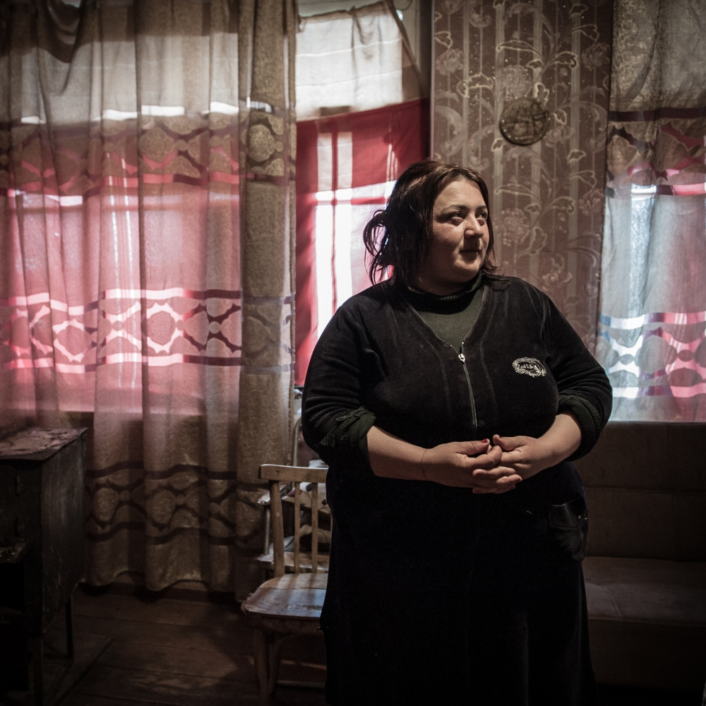 "Maka Lomsadze, 42, lives in the village of Khveti, where the mountains divide Ossetians and Georgians.  ""We had and still have Ossetian friends in Tskhinvali, we visited each other with our families. We could not imagine that it would be a war, even when the bombs started falling down. We had to leave our villages. People started new lives, with too many problems suchs as poverty and constant fear. All of our life returned here, near the conflict zone."""