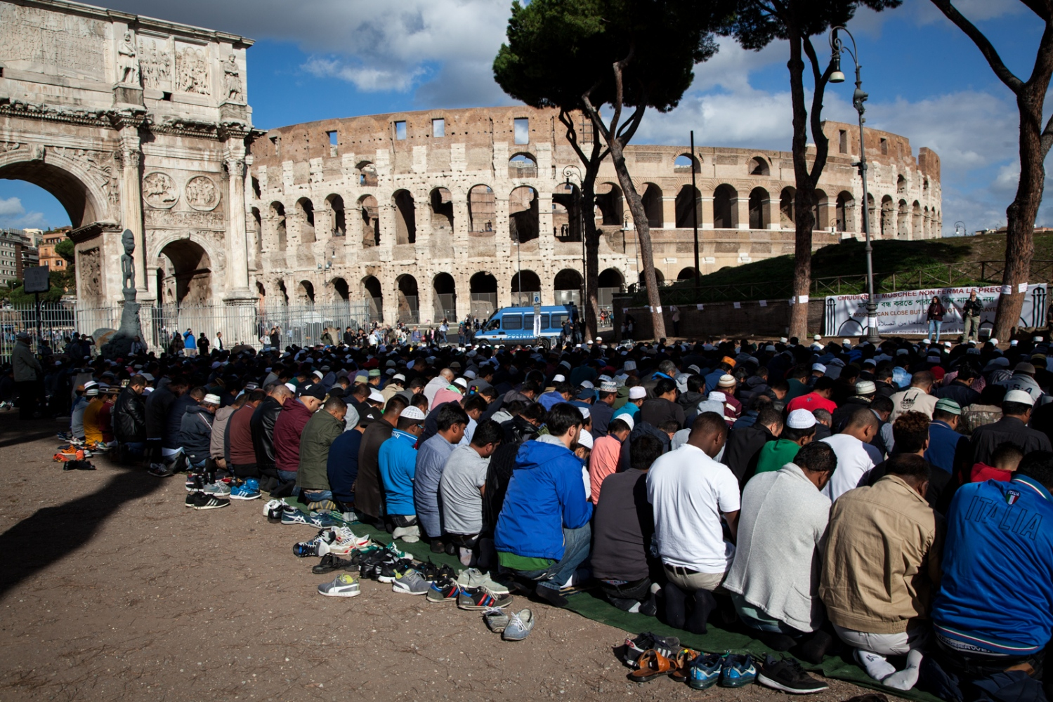 Oct. 21, 2016 - Hundreds of members of the Muslim community of Rome are gathered for the Friday communal prayer in front of the Colosseum, in Rome, to protest against the closure of a few mosque in the southeastern part of the city.