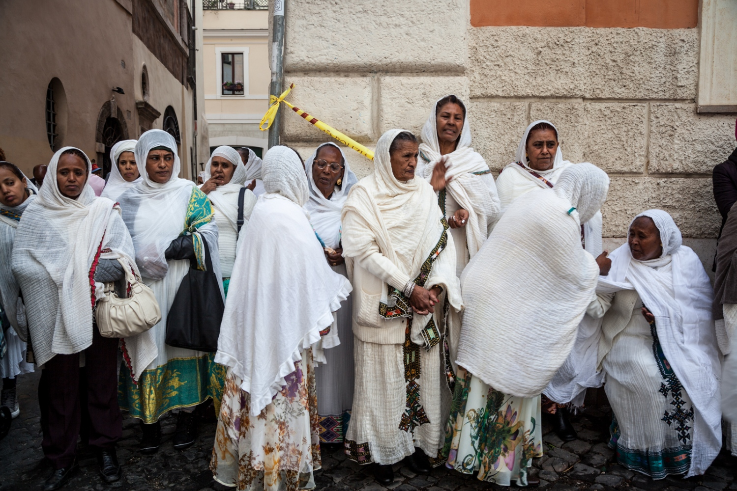 Nov. 23, 2014 - Members of the Eritrean Orthodox Tewahedo Church talk outside St. Michael's Church in one of the most iconic areas of downtown Rome, during the celebration for the patron saint of the community.