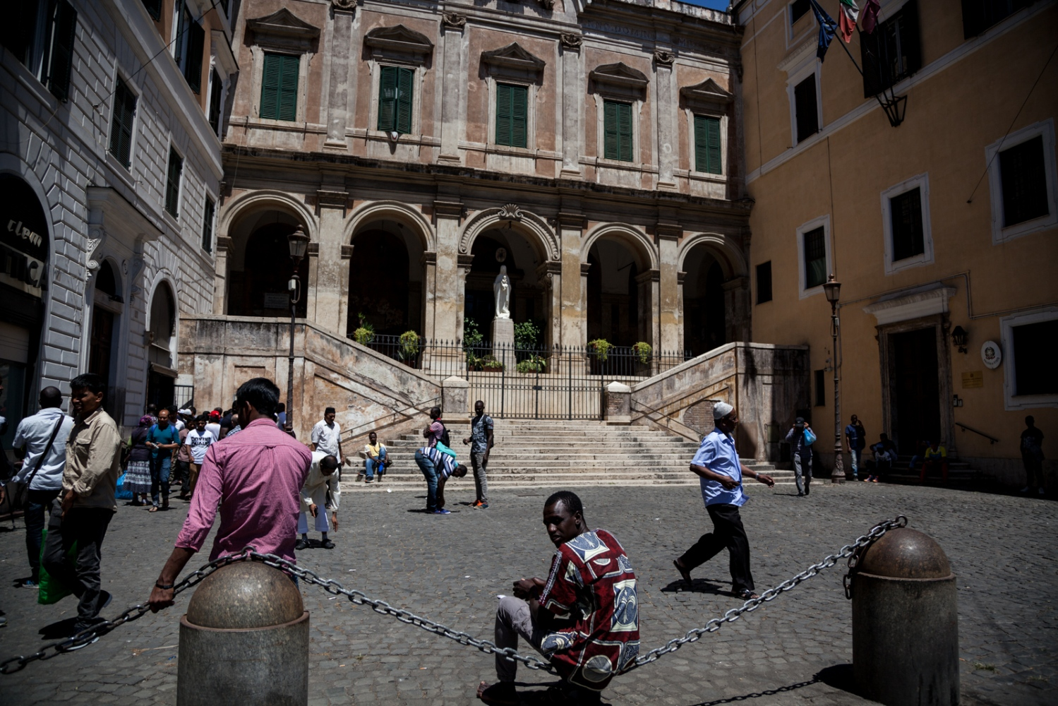 July 07, 2017 - After the afternoon Friday prayer, men leave a small Mosque next to a Catholic Church (Chiesa di Sant'Eusebio) in Piazza Vittorio, the most multicultural area in downtown Rome.