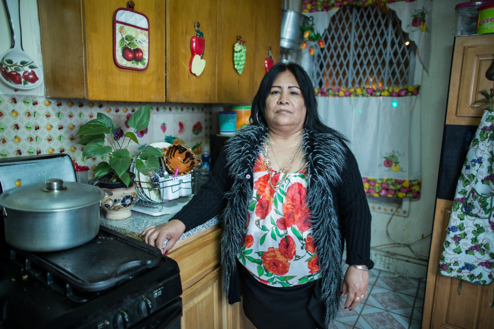 Juanita Torres de León , in the kitchen at her home on 59th. Street, Sunset Park, Brooklyn. She was born in Atencingo, Puebla, but 27 years ago she lives with her whole nuclear family in Sunset Park, Brooklyn, New York. Juanita is a member of  St. Jacobi 's Church and coordinator of the community kitchen. Juanita was part of the team that eventually came to be known as ¨Occupy Sandy¨ in 2012, feeding the volunteers who were helping hurricane victims.