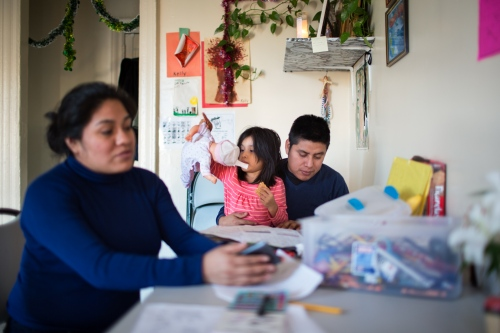 After Zenaida picks up her children from school, she helps her children to do their homework, Her husband helps when he has a free day. Although they do not know much English, for them it is important to get involve in the education of their children. Bronx, NY