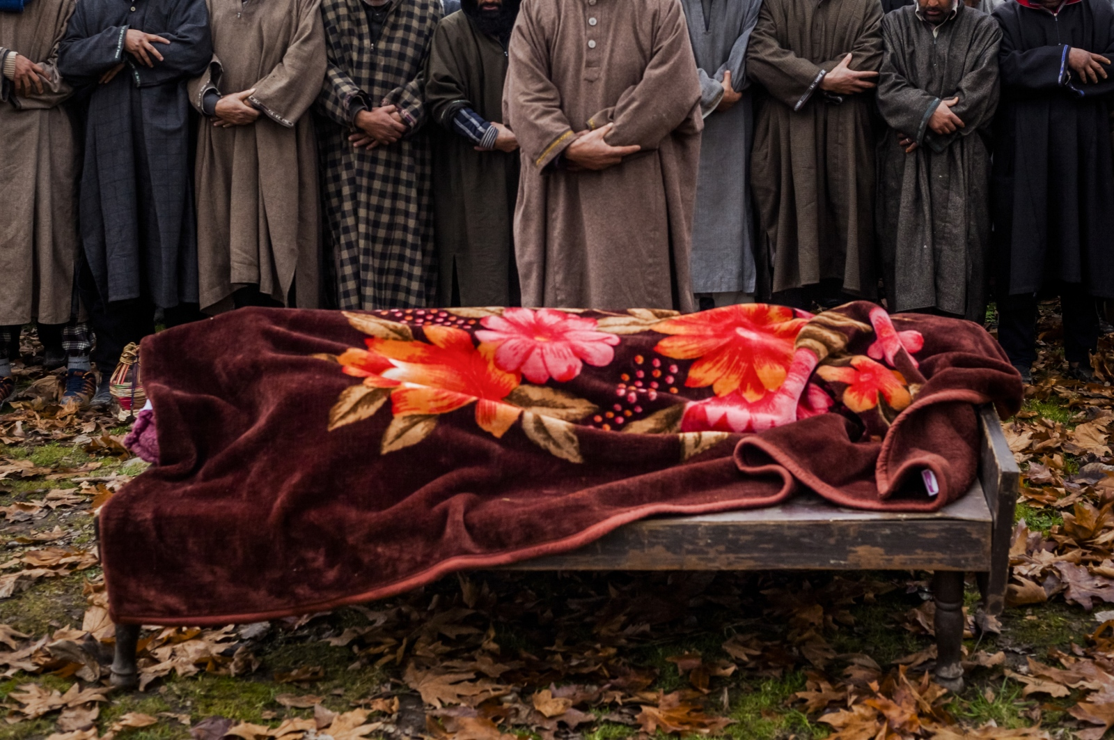 Kashmiri mourners offer prayers during the funeral of Rasiq Ahmed Khan, aged around 22, and who was found shot to death, in Watchohallan village in Shopian, south Kashmir, some 80 kms from Srinagar, on December 14, 2015. Raisq, who disappeared on December 13, was found shot to death by gunmen who local residents report were members of the Indian police Special Operations Group.