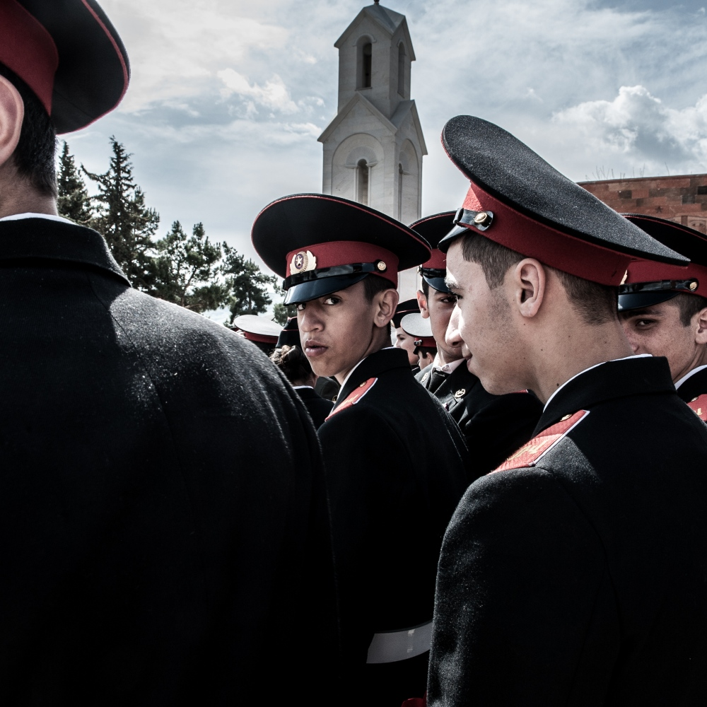 Young police cadets observe the Armenian Genocide Remembrance Day. Hundreds of people walk to the Genocide Memorial to lay flowers at the eternal flame.