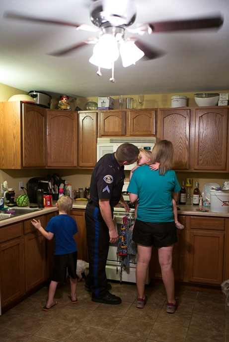 Pete kisses his family before heading to work as a police officer. Pete cherishes the time he has with this family.