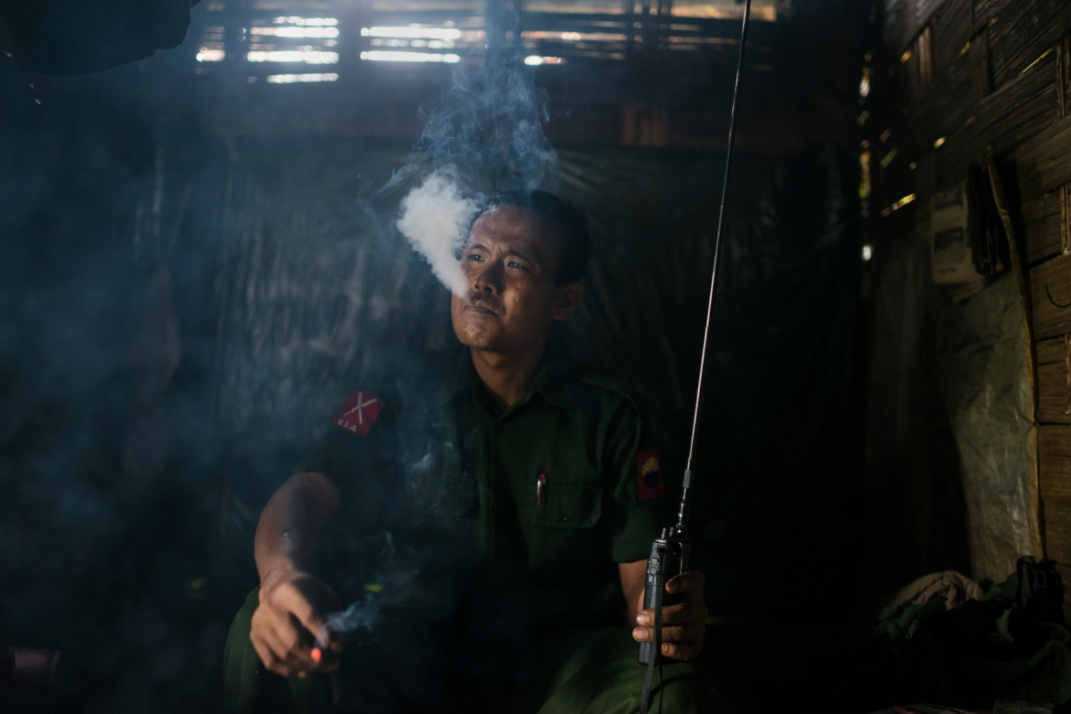 Lieutenant Brang Seng of the Kachin Independence Army having a smoke at a base camp near Mai Ja Yang in Kachin State, Myanmar.