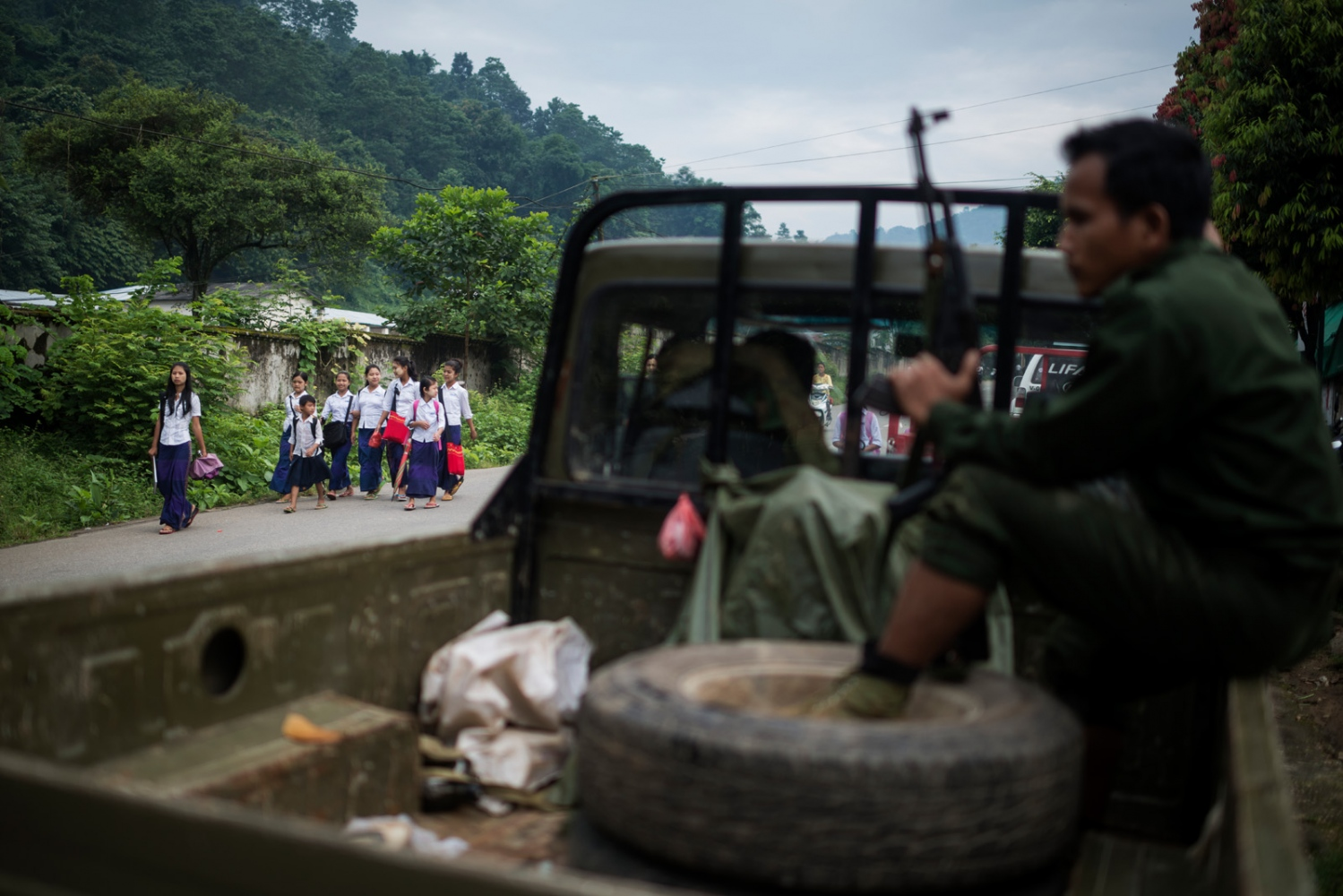 A group of children passes a K.I.A. rebell truck on their way to school in Laiza, Kachin state, Myanmar.