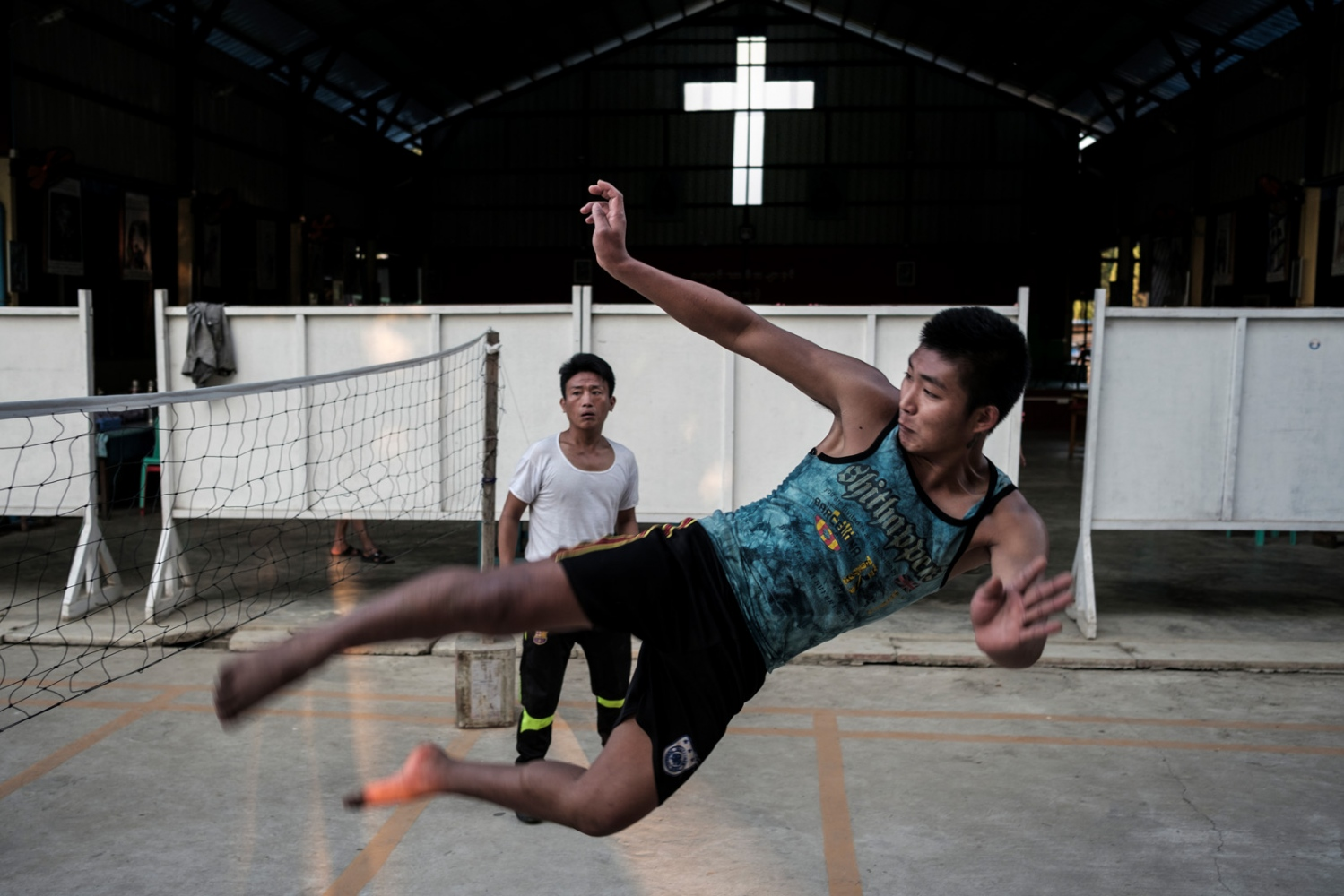 Clients play Chinlone, a popular local sport, at a Catholic drug rehabilitation center in Myitkyina, Kachin State, Myanmar.