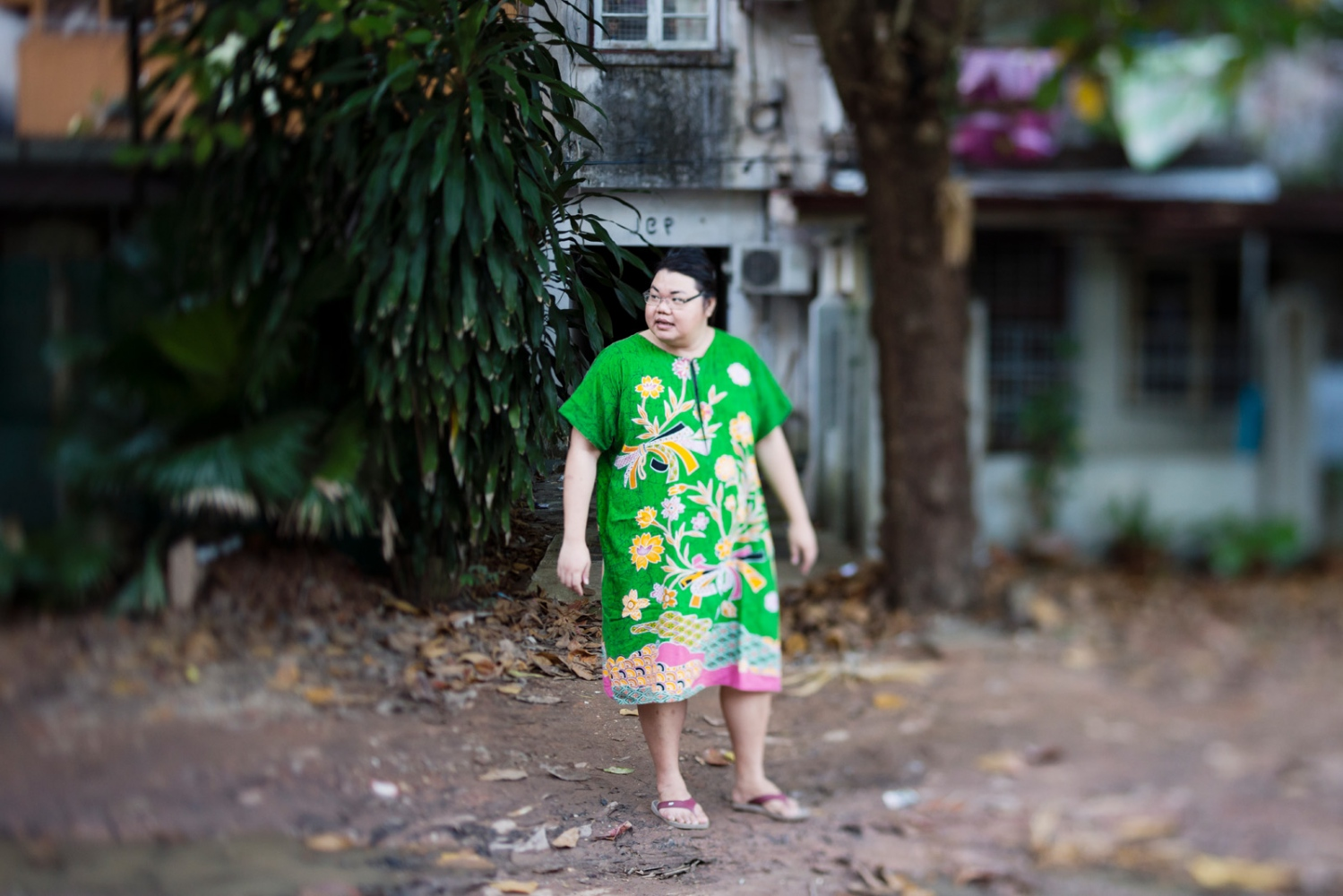 Yaya, outside her apartment in Yangon.