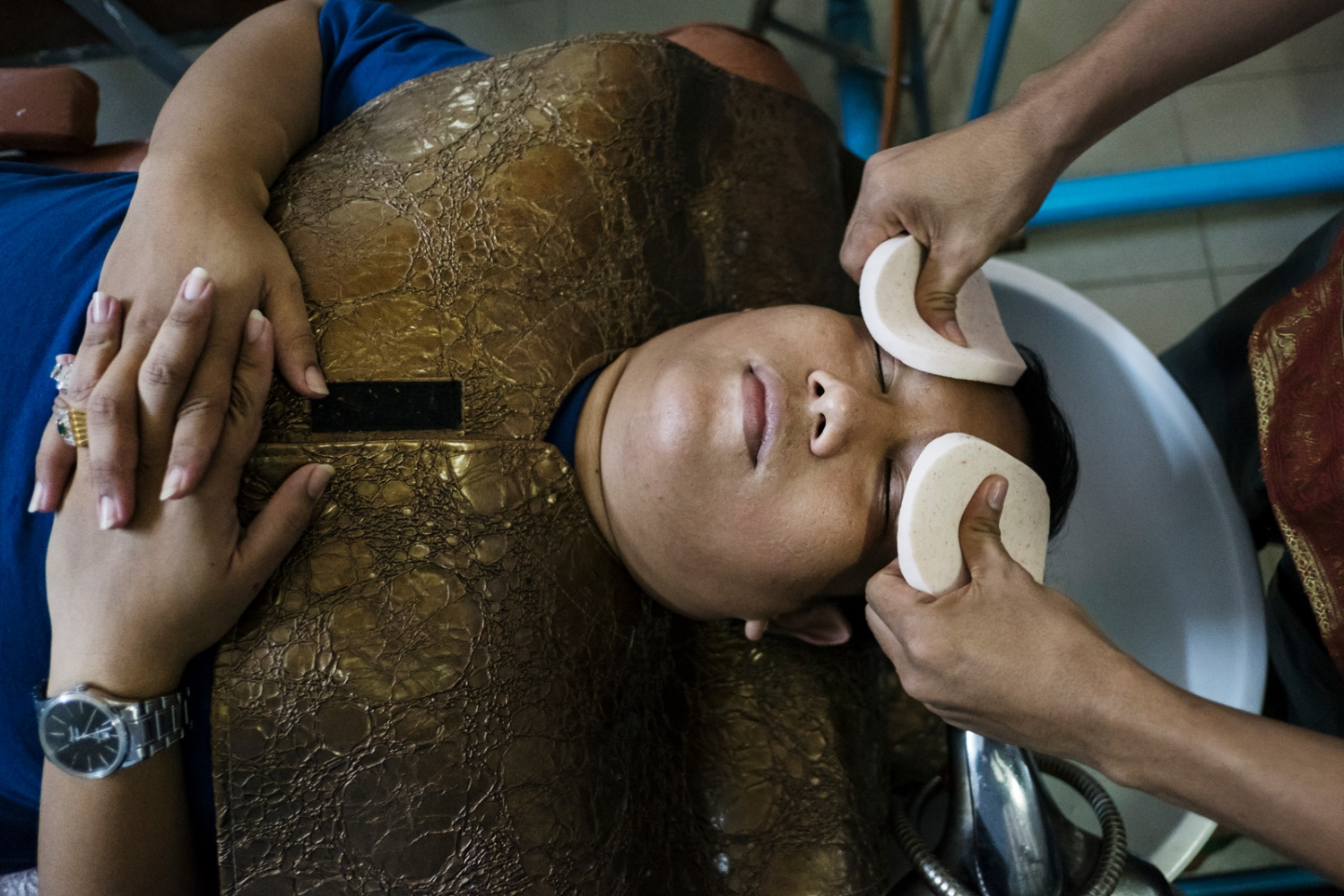 "Ye Htut Soe gets a facial massage at a massage salon ""for men""."