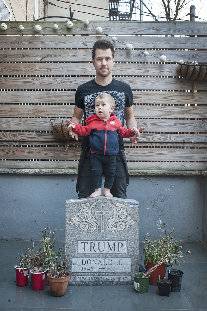 """Brian Whiteley is an artist known for a tombstone featuring Donald Trump's name. It appeared on Easter Sunday, 2016, in the middle of Central Park to massive media attention and eventual police involvement. The idea came during Trump's opening campaign speech. """"I made the epitaph as a way to get him to reflect on what he's doing and possibly make a change,"""" he said. It was also a reflection of Trump's name which often appears on his properties. The tombstone is made from Vermont granite and weighs around 500 pounds. It states, """"Donald Trump, 1946 ~, Make America Hate Again."""" Whiteley worked with a Trump-supporting carver at Supreme Memorials in Park Slope to create it. Once it was installed in Central Park around 5A.M., """"It was all over the news, it just kind of blew up. I was on the New York Times crime section, then on the arts section the next day,"""" he said. The police confiscated the tombstone. Then the secret service began investigating Whiteley. """"They interrogated me, took fingerprints and photographs, mental health records, which books I was reading, if I owned a gun, if I knew martial arts,"""" he said. Thankfully, there is no death date assigned on the tombstone, which he believes may have constituted a threat. """"My mother voted for Trump. I have a hard time talking with her now. We're talking about basic moral issues. Human rights. Repealing Obamacare, which you had your grandchildren under. This directly affects you and you're not comprehending this,"""" said Whiteley. """"Trump is not an example for my son or anyone to look up to."""""""