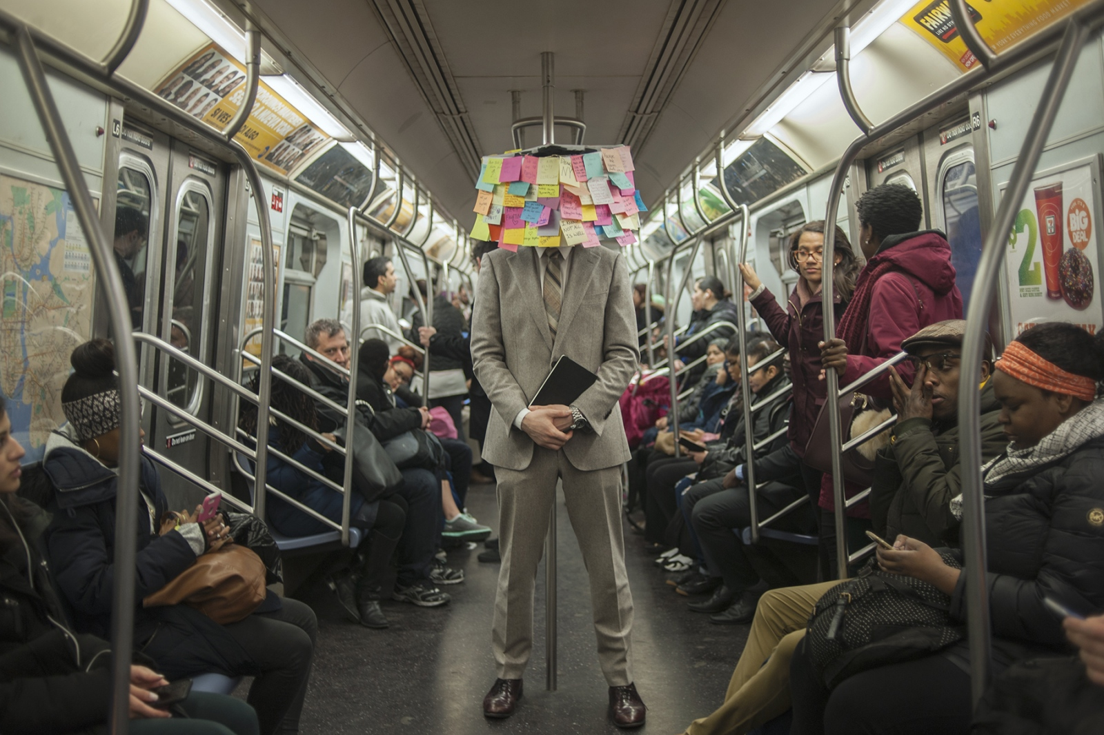 """The day after Election Day, Matthew Chavez, """"Levee,"""" brought out sticky notes to the 14th Street subway tunnel between 1, 2, 3, and L trains. Over 10,000 people participated. These post-its soon lined the walls of 14th St station, providing """"Post-Election Therapy"""" (The Guardian) to New Yorkers during their daily commute. Chavez said he started Subway Therapy while thinking about absolution and the elections. """"I thought, what could I do to translate their messages into a beautiful body of work?"""" He wanted people to celebrate being part of a diverse community and voice their thoughts in this time of """"division and stress."""" The man behind Subway Therapy is careful to stay in the center, and did not disclose his leanings to those he interacted with. """"Subway Therapy"""" has since been published into a book by the same title, and a portion of of the post-its have forever been preserved at the New York Historical Society."""