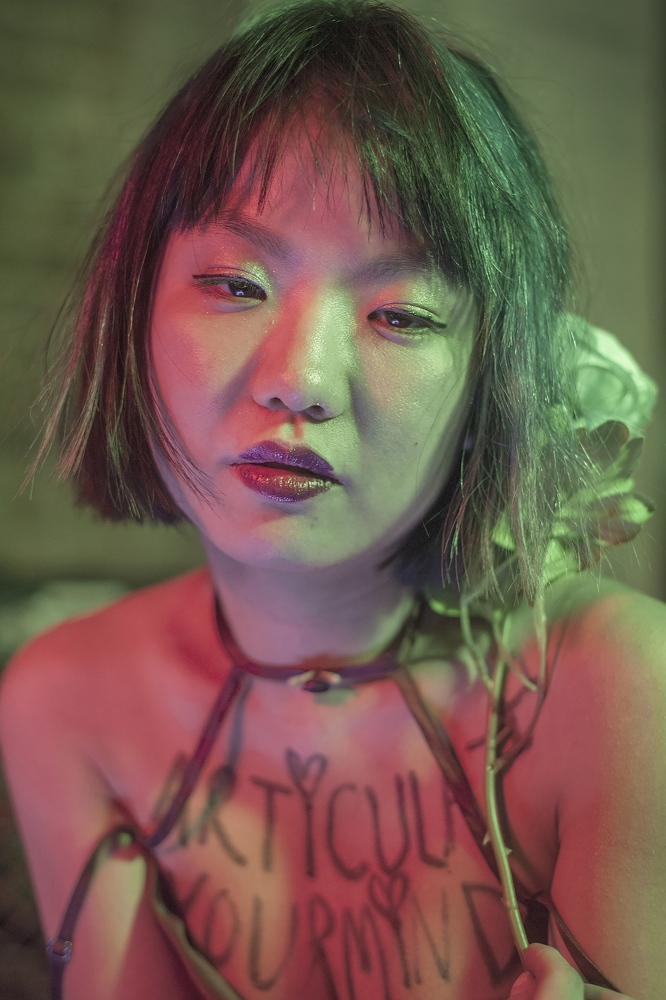 "Seonjae Kim is a Korean American theatre director from Seoul, South Korea. She debuted her most recent musical production in February 2017, Riot Antigone, a feminist punk rock adaptation of Sophocles' Antigone at La MaMa Experimental Theatre Club. Kim is inspired by the 90s Riot Grrrl movement, which she said mobilized young women to find their musical and political voice. She described her Antigone as a coming of age story rather than a tragedy. Kim sees art as a tool that can help change minds of those with decisionmaking power. She said she decided to hire an all-female cast the morning after the presidential elections. ""I didn't want to see men oppress women onstage. That was already so elevated,"" she said. ""I was more interested in young women telling the story together, stepping into the role of the oppressor to try to understand that."" Antigone, the main protagonist, grapples with pressure to conform and female revolt. Kim said that subconsciously, the play became about Hillary Clinton – or anyone who's done something extreme for their beliefs. ""All the ideas I had on the show made sense after her concession speech,"" she said. ""Antigone is Hillary. She fought for what she thought was the right thing to do, but she wasn't a perfect person and that has consequences. When she fails, she was asking for it."""