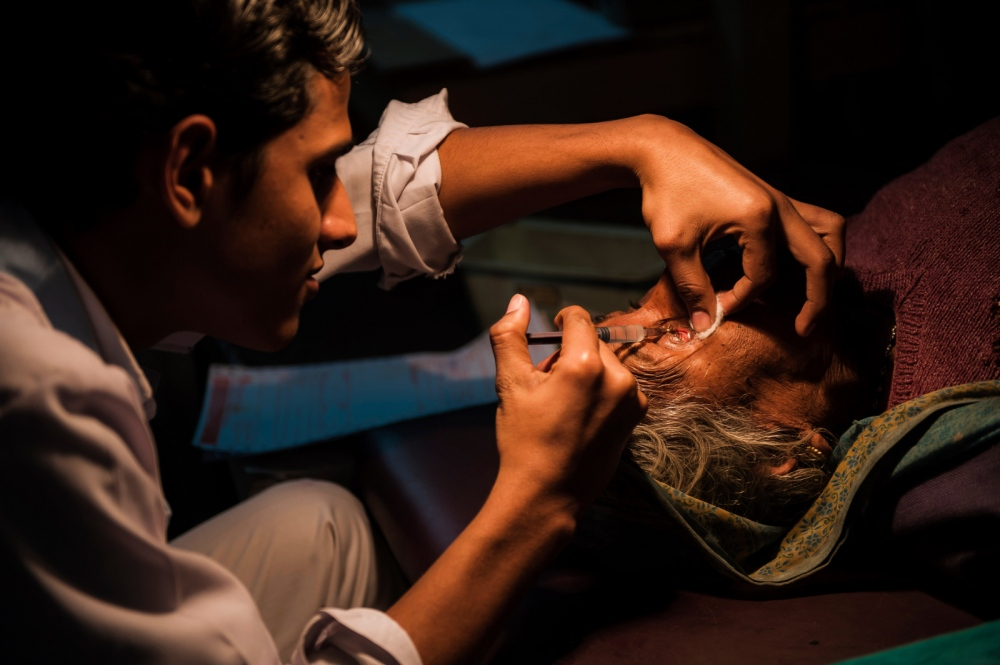 A surgical technician administers an eye block.