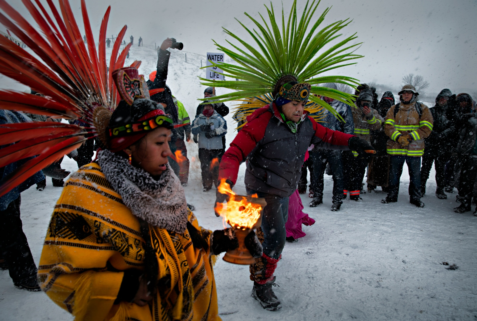 Aztec dancers accompanied the Veterans for Peace march  during a December blizzard near the Oceti Sakowin camp.