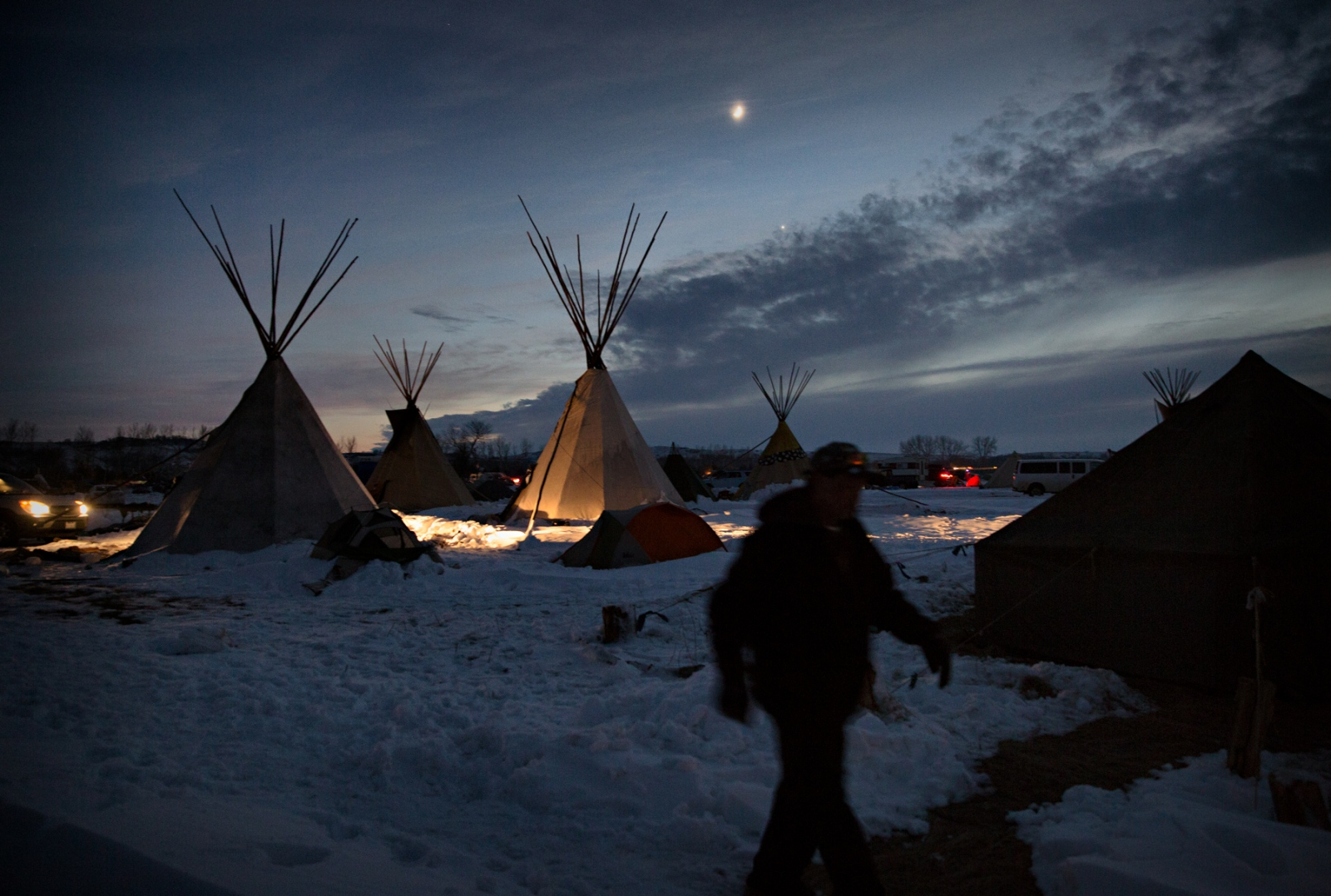 The moonlight covers the Camp after the sun down on an almost clear night during a frigid November night. The Camp's atmosphere was happy after the Army Core of Engineers issued a decision to halt the Dakota Access Pipe Line and denied the easement sought by the oil company to drill under the Missouri River. The victory did not survive the election of Donald Trump as the 45th President of the United States.