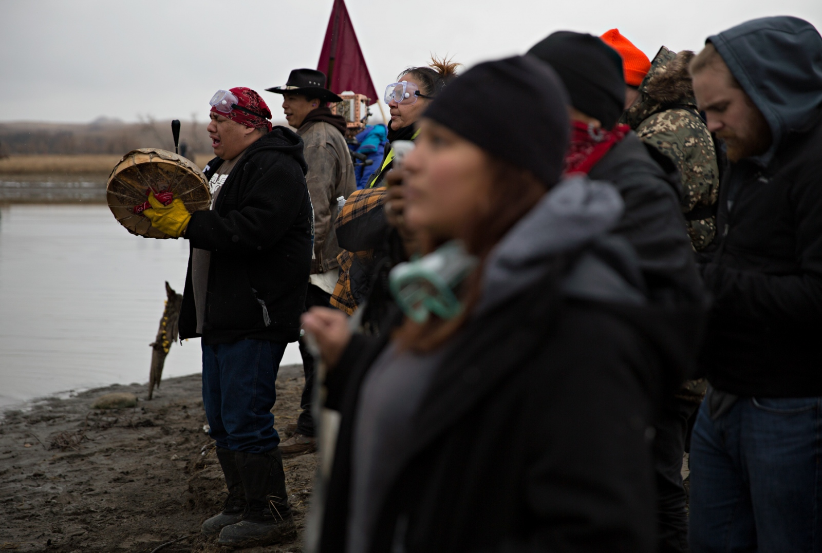 While a bridge that was destroyed by the local law enforcement was being rebuilt, water protectors chant in response to the law enforcement directives to leave the area.