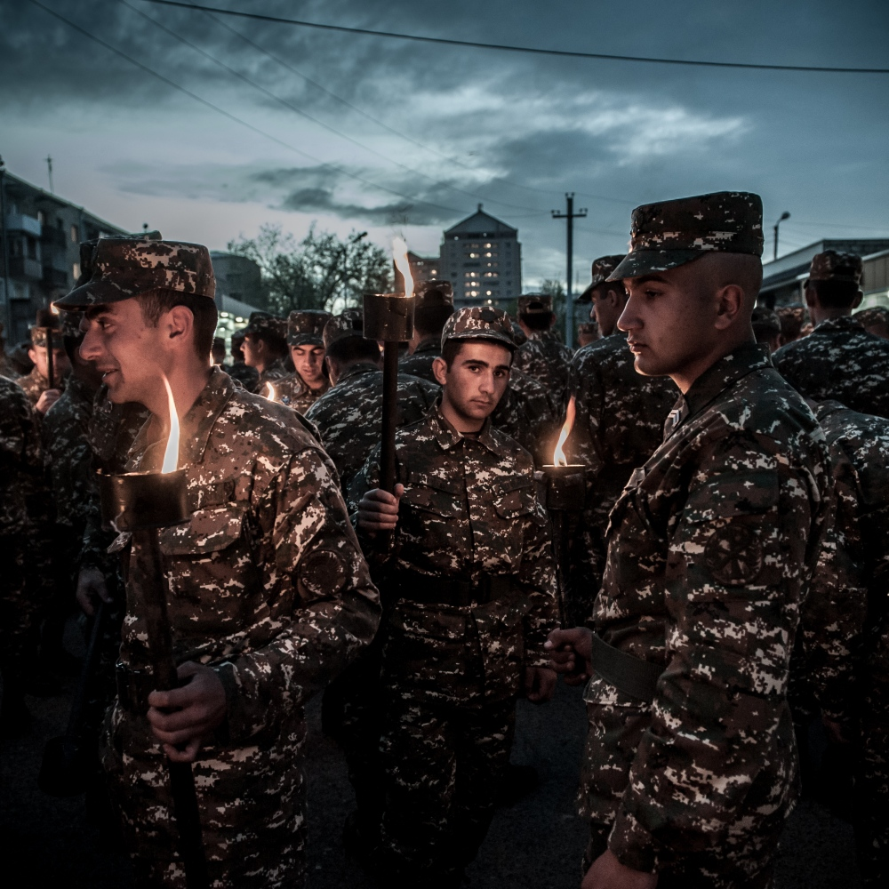 Young soldiers commemorates the victims of the Armenian Genocide the night before the Armenian Genocide Remembrance Day is officially observed. A huge number of people march through the capital's streets with torches in hands.