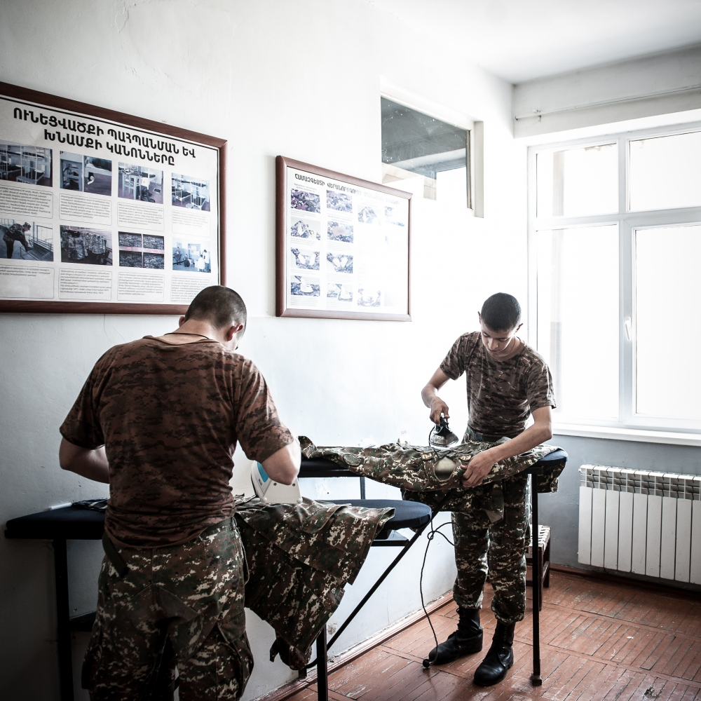 Young cadets iron their military uniform after finishing classes in the military high-school in Stepanakert.