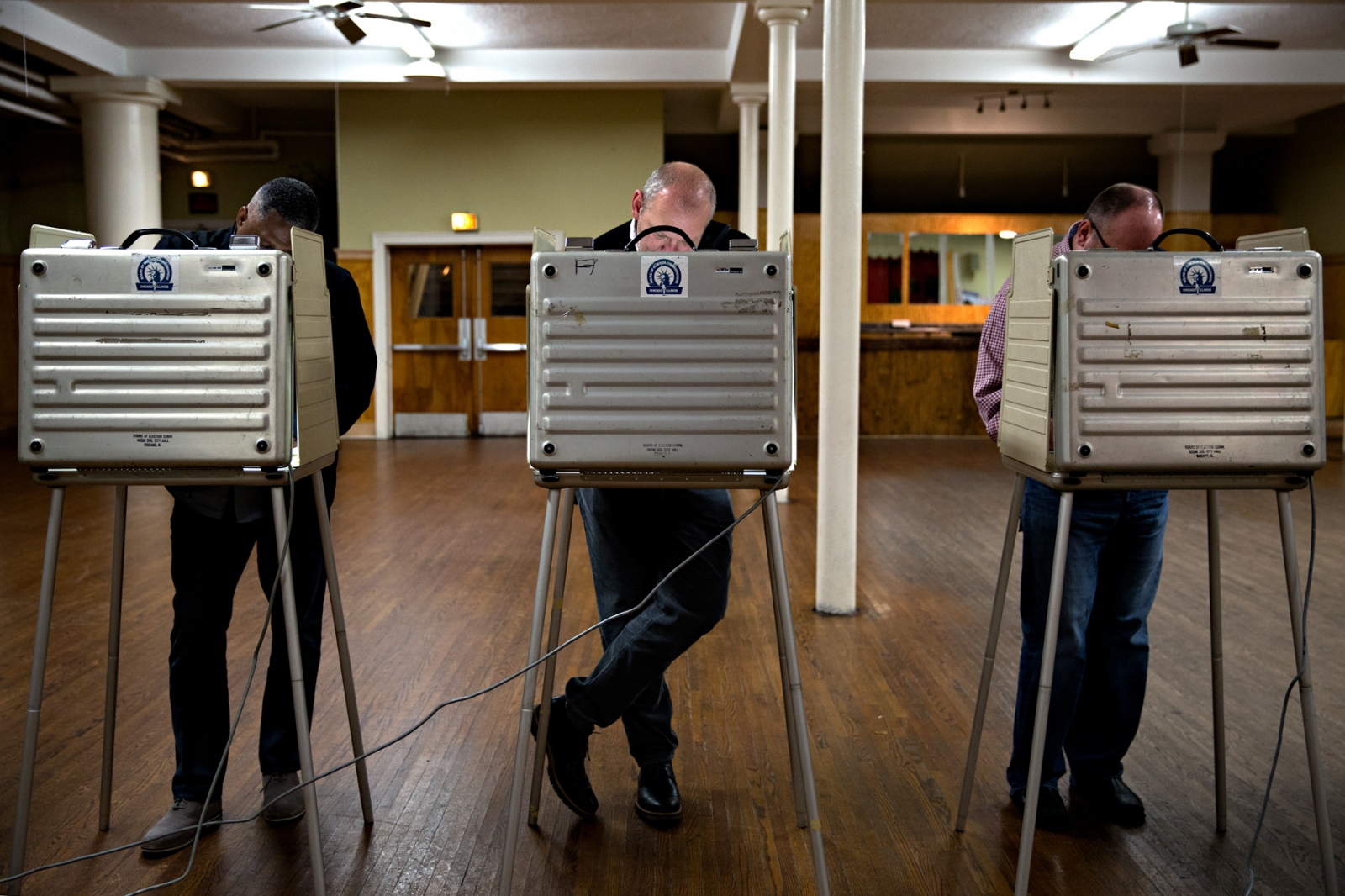November 8, 2016 - Chicago, Illinois - November 8, 2016, eligible Americans stood behind voting booths to vote for their presidential candidate of choice. In one of the biggest upset in any presidential race, the widely seen as the favorite Hillary Clinton lost her presidential bid to Donald Trump who became the 45th President of the United States.