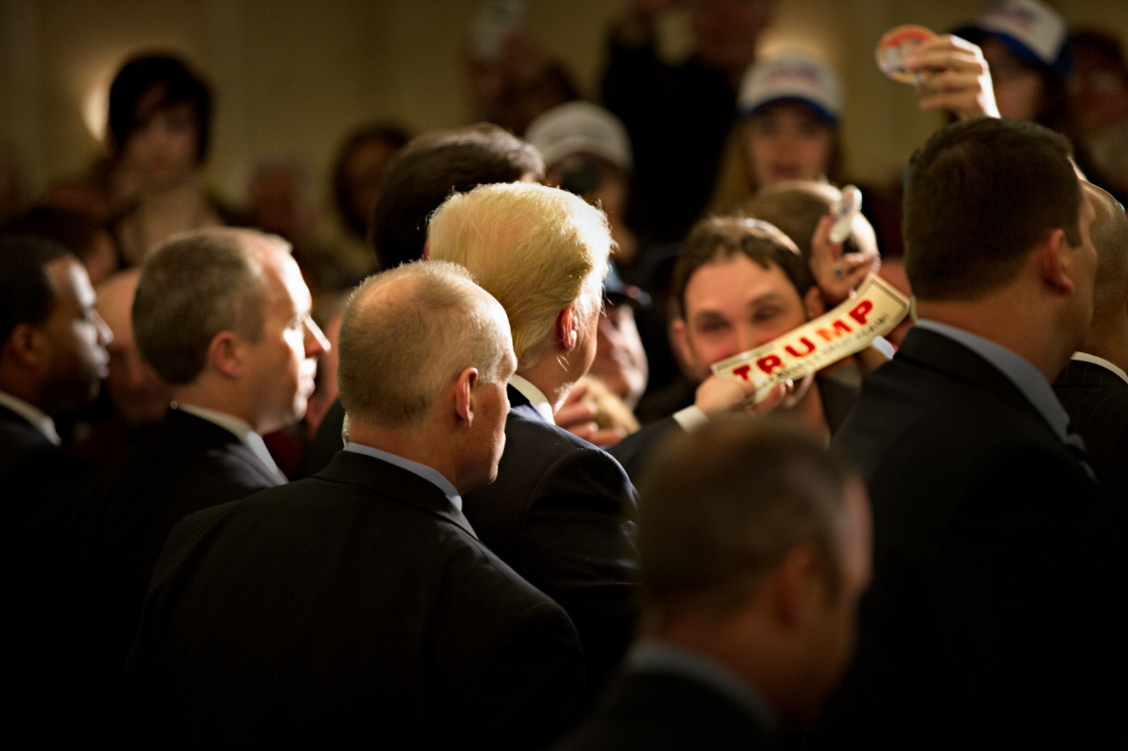 March 30, 2016 - Appleton, Wisconsin - Surrounded by members of the secret service Donald Trump signs autographs and meets with his supporters after a rally in Appleton, Wisconsin.