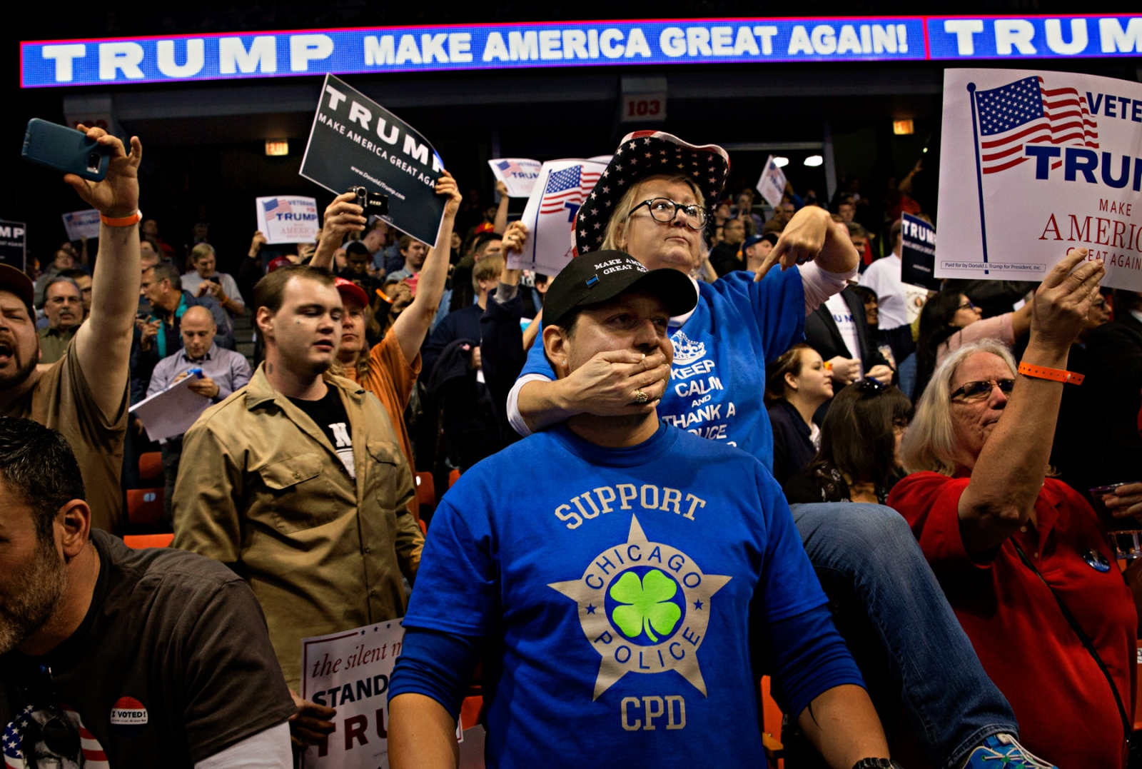 March 11, 2016 - Chicago, Illinois - A group of Chicago Police Department officers and their family attended a rally planned by Donald Trump in the University of Illinois at Chicago. Before it became apparent the UIC students along with members of Black Lives Matter organization had filled the Pavilion with their supporters, the CPD officers engaged in a verbal assault with anti-Trump protestors inside the Pavilion before the protestors were escorted out.