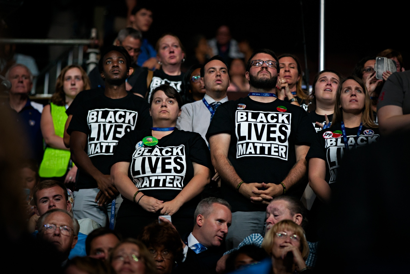 July 26, 2016 - Philadelphia, Pennsylvania - Black Lives Matter supporters stand in defiance during the Democratic National Convention when it became clear that Hillary Clinton was going to be the nominee. Bernie Sander supporters believed that the DNC was actively supporting Hillary Clinton in contravention of the DNC rules to remain neutral in the process.