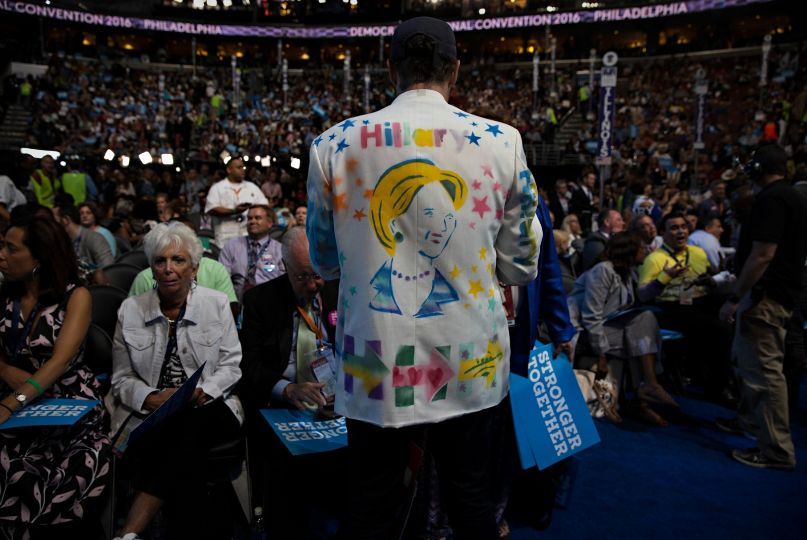 July 26, 2016 - Philadelphia, Pennsylvania - A Hillary Clinton supporter wearing Her colors, leads delegates into pro-Clinton chants during the Democratic National Convention in Philadelphia, Pennsylvania.
