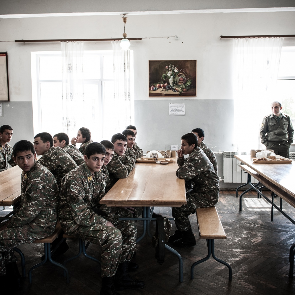 Young cadets wait for a snack in the mess hall of the military high-school in Stepanakert.