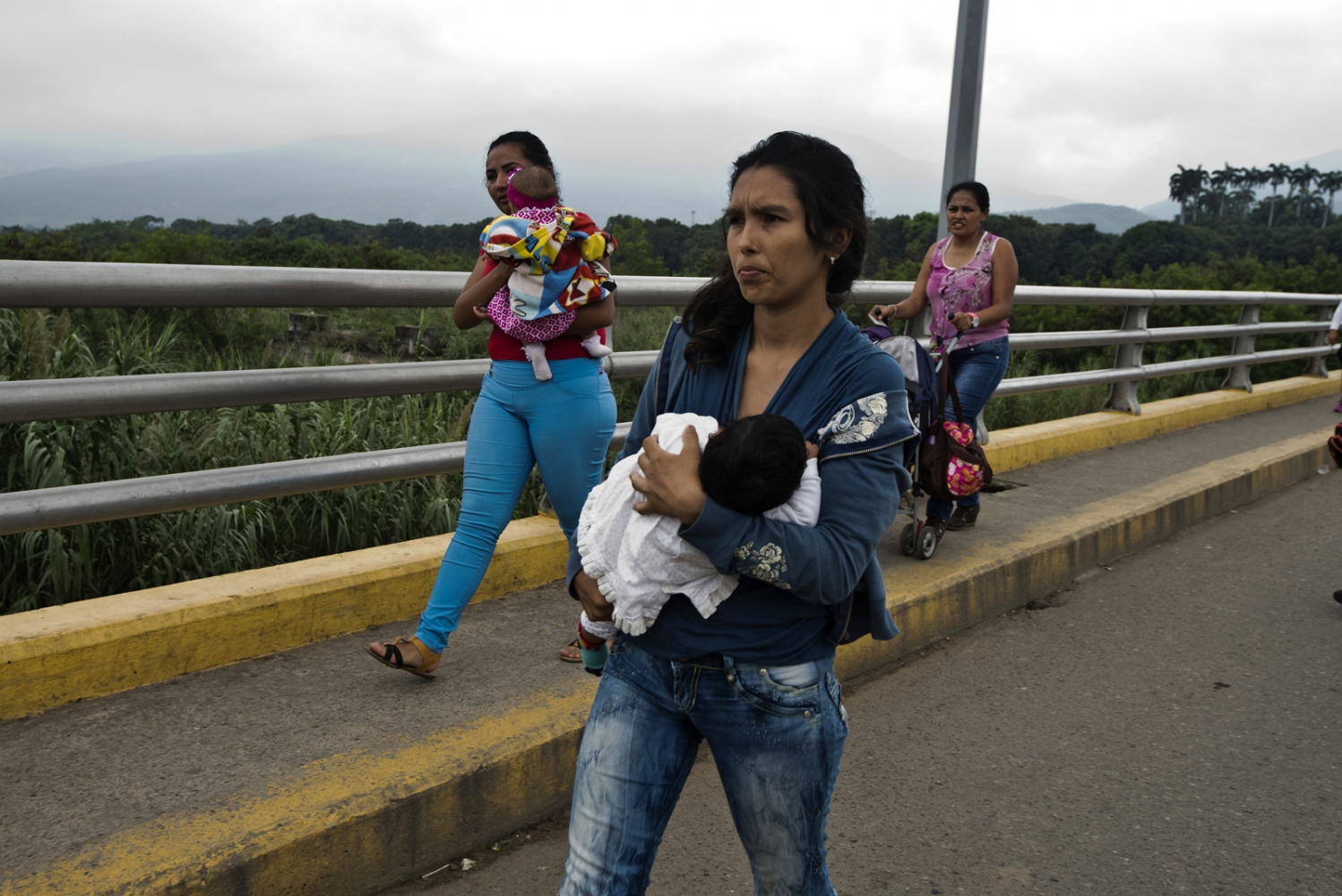 Venezuelan mother crosses the Simón Bolívar border point between Colombia and Venezuela to find supplies for her family on March, 2017 in Cucuta, Colombia.