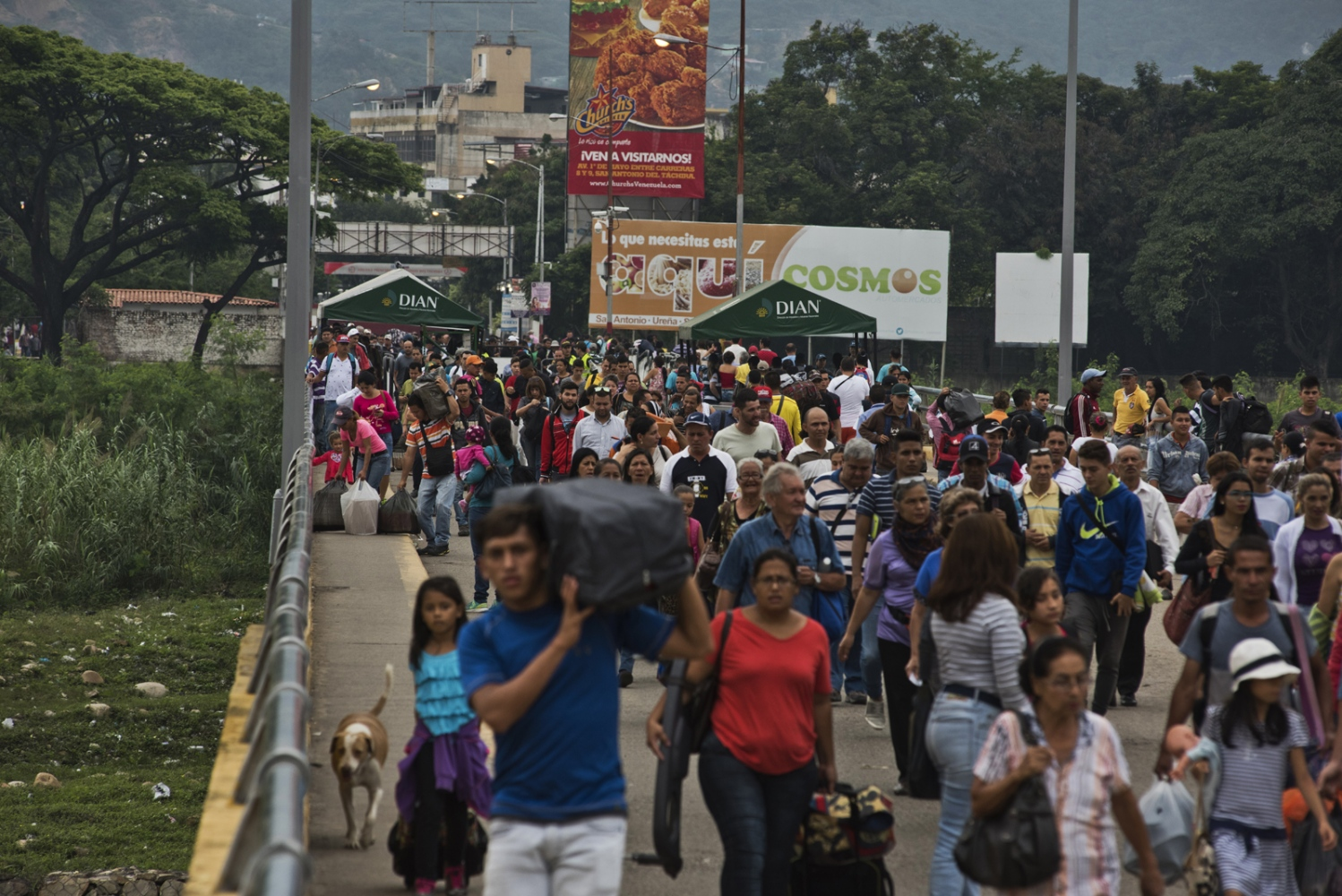 Hundreds of people cross from Venezuela to Colombia through the Simon Bolivar border point to find medicines, food, supplies, or informal jobs on March, 2017 in Cucuta, Colombia.