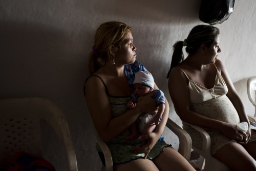 Consuelo Izagarra, 25, a Venezuelan woman who is the sister of Gerlimar Pastran, cares for newborn Juan Diego outside of the small room where the family is living in the La Libertad neighborhood on March, 2017 in Cucuta, Colombia.
