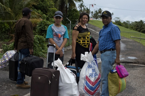 Gina Lugo Venezuelan woman and her family are waiting for immigration process to leave Trinidad and Tobago in Cedros Port. Inside their bags they are transporting wheat flour,personal care products, milk ,coffee and oil.